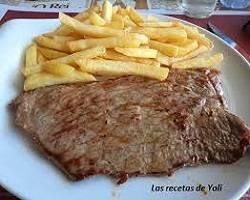 Bistec de vedella amb patates fregides