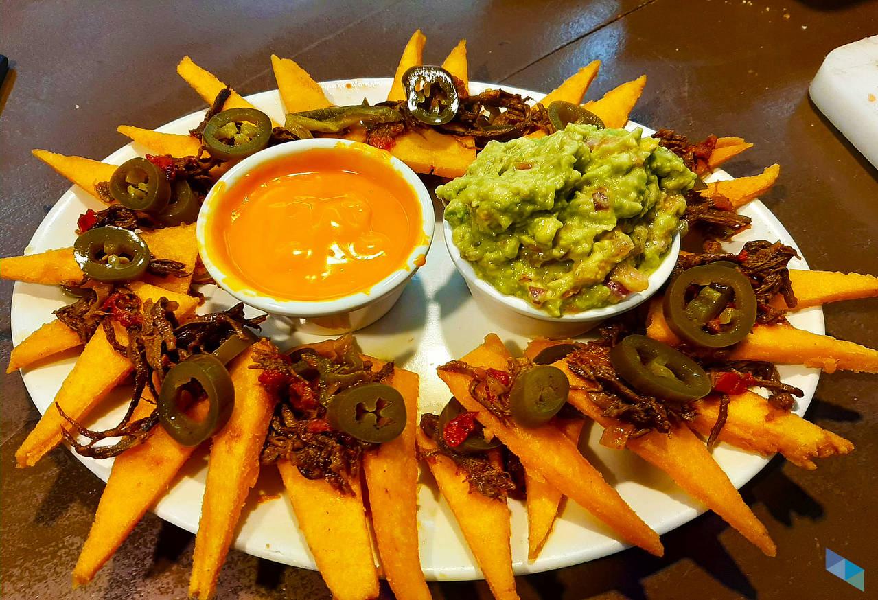 """Our specialty: Artisan Nachos"" Restaurant Tal Qué"