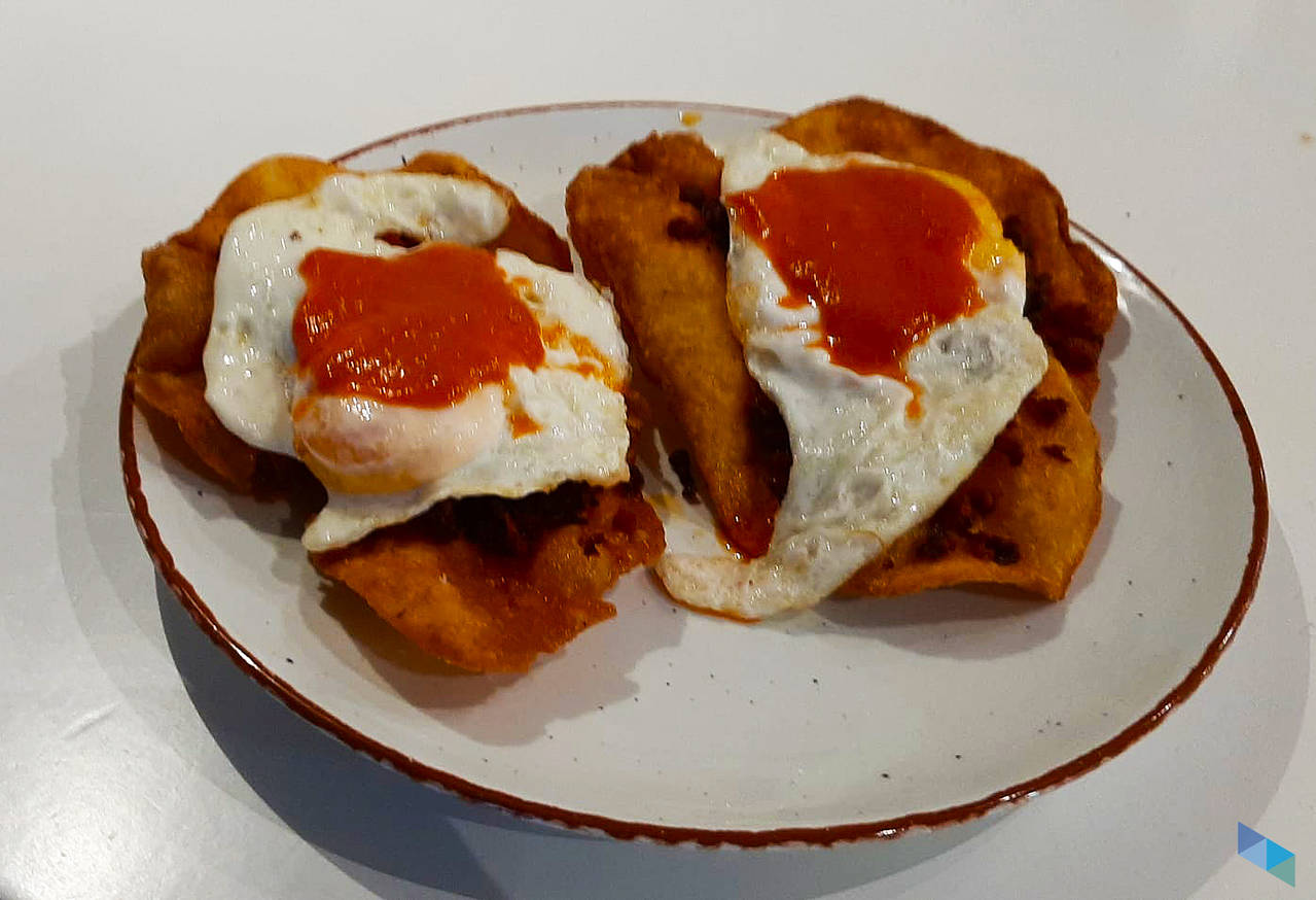 """""""One of our specialties; fried egg with brave sauce on Asturian lathe"""" Tal Qué Restaurant"""