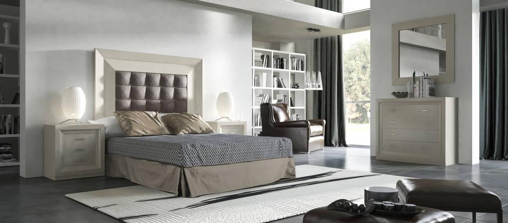 Dormitori amb capçal entapissat