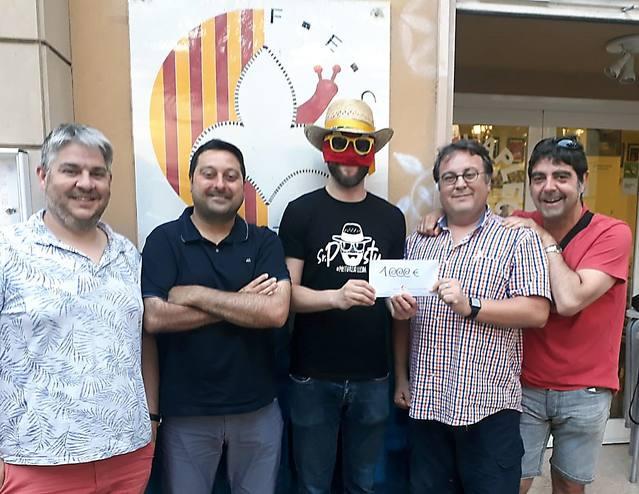La Fecoll lliura al Sr. Postu 1.300 euros per entitats benèfiques